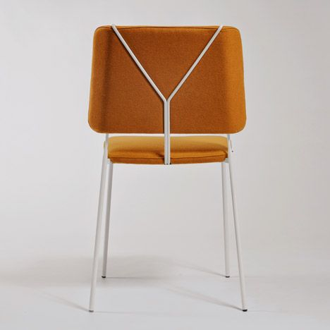 This chair by Swedish-French design duo Fredick Färg and Emma Marga Blanche features a metal frame that mimics trouser braces on its back
