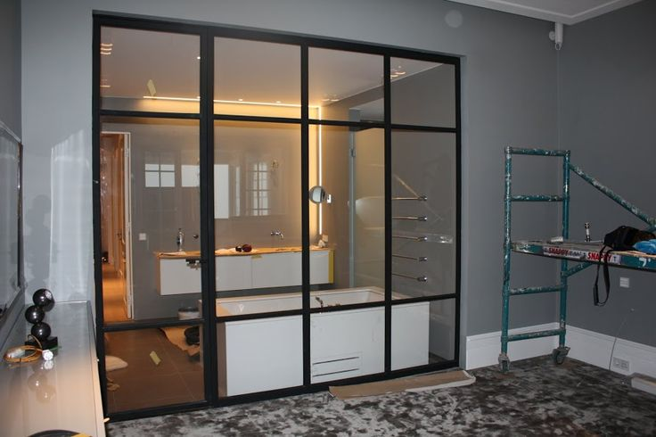 Painted black mat, metal doors with clear glass and hidden hinges. its simplicity perfectly fit to almost every interior. Realization by Zbigniew Bakanowicz  Oslo - Norway