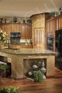 "Mediterranean kitchen... An update to and ""Old"" and outdated cabinetry in the kitchen!  Faux accent wall and all of the little touches make this very Tuscan....a great look for a ""update""."