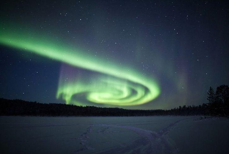 Spiral Aurora Over Finland (i.imgur.com)