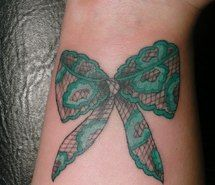 Lace bow, tattoo by Amanda Go - love lace tattoos