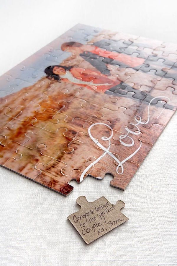 Custom printed puzzle used for wedding guest book alternative. Guests sign a piece of the puzzle for the newlyweds to read later as they assemble their wedding puzzle.