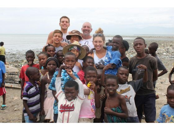 """The Jervis family travels to Cite Soleil, Haiti every summer to hold a basketball camp for the city's youth. They've done so the past two years. Dad Jerry Jervis said """"Going back is still the highlight of our year."""""""