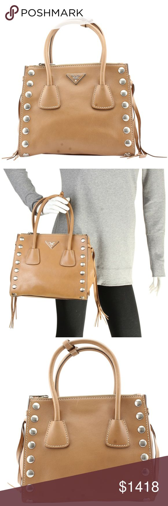 """Prada B2625R Tan Leather Satchel (117687) This Prada satchel is new without tags. •Exterior Condition: New •Interior Condition: New •Type: Satchel •Material: Leather •Origin: Italy •Interior Lining: Nylon •Hardware: Silver-Tone •Meas (L x W x H): 10.5x6.5x9 •Strap Drop: 20"""" •Handle Drop: 9"""" •Exterior Pockets: 0 •Interior Pockets: 5 •Odor: None •Age Group: Adult •Weight: 2.675 lbs •Production Code: 231 Prada Bags Satchels"""