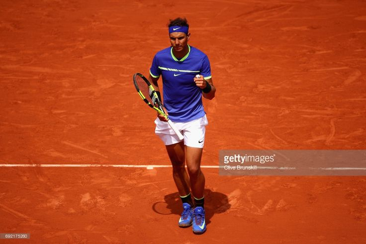 Rafael Nadal of Spain celebrates victory during the mens singles fourth round match against Roberto Bautista Agut of Spain on day eight of the 2017 French Open at Roland Garros on June 4, 2017 in Paris, France.