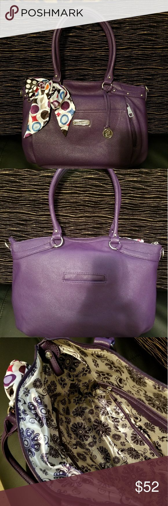 Grace Adele purse Awesome purple in color with a beautiful inner satin lining. There are countless compartments both inside and out! There is a pretty decorative scarf tied to one handle. This purse is brand new, and never used, although there is a small defect as shown in the photo. Grace Adele Bags