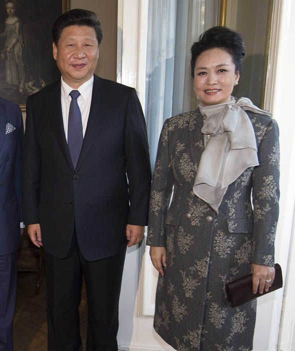 Xi Jinping and China's First Lady Peng Liyuan, meet the Prince of Wales and the Duchess of Cornwall at Clarence House, London for China Tea on the first day of the President's state visit to the UK .