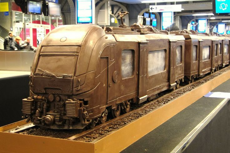 A train made entirely of chocolate has set a new Guinness World Record as the longest chocolate structure in the world. The sculpture, on display at the busy Brussels South station, is 112-feet (34.05 meters) long and weighs over 2,755 pounds (1250 kilos) Maltese chocolate artist Andrew Farrugia spent over 700 hours constructing the masterpiece. — at Brussells South Station.