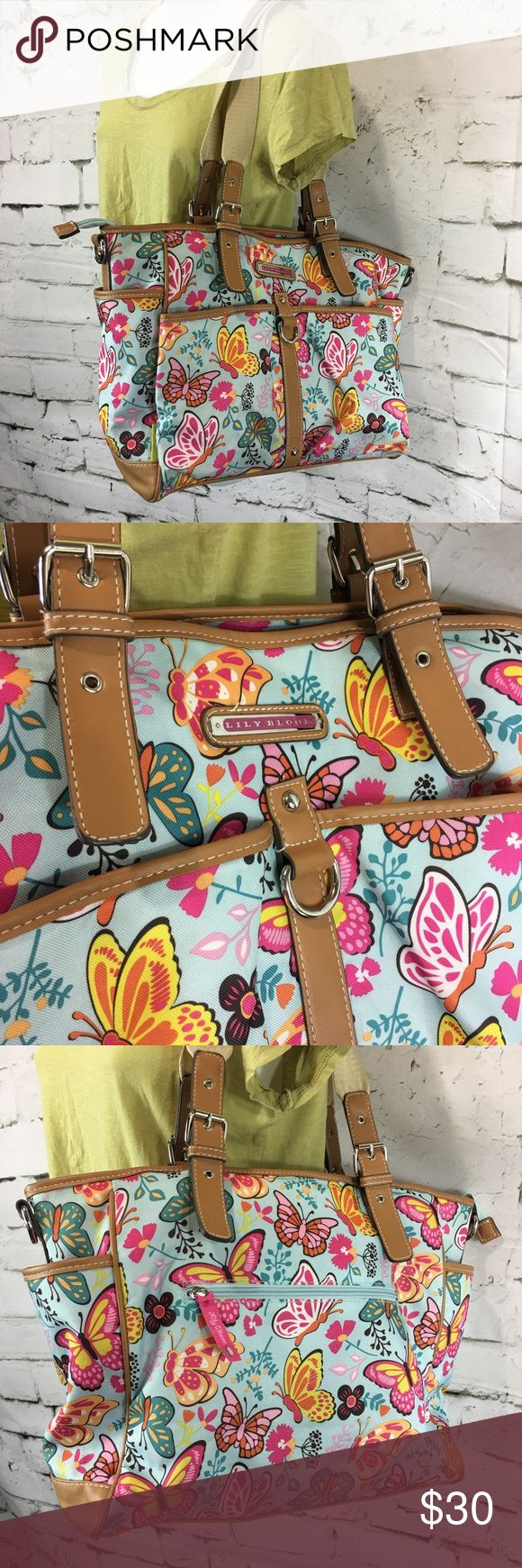 Lilly Bloom Butterfly Floral Print Large Purse 👛 Lilly Bloom Butterfly Floral Print Large Shoulder Bag Multi Color Purse Handbag 3 large compartments, key hook, several small interior pockets 5 outer pockets / pouches Could double for a great diaper bag There are a couple small spots on interior (see pic) Overall nice condition Lily Bloom Bags Shoulder Bags