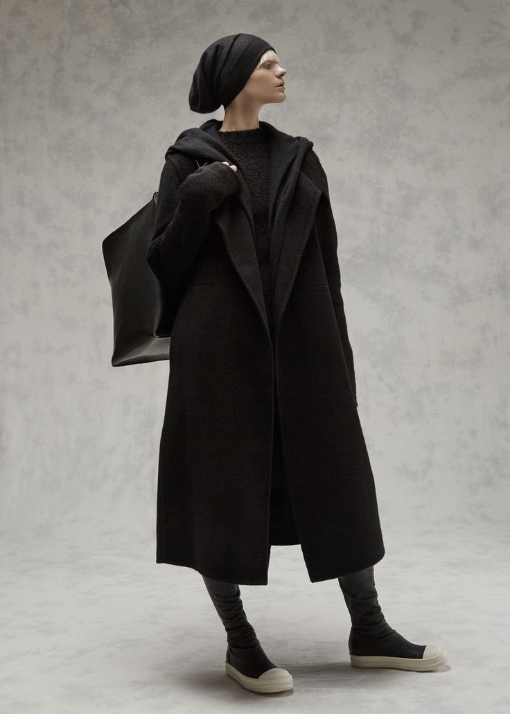 Sleeveless oversized cardigan in black cashmere with hood, seam pockets, and double breasted buttons at collar. Dry clean only.