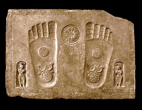 """A Buddhapada stone featuring two yakshis. India; Gandhara region; circa 1st-2nd century C.E. grey schist; 89 x 127 cm."""