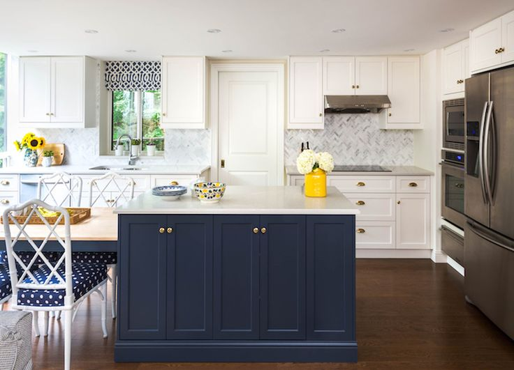 White And Navy Kitchen Features Shaker Cabinets Paired With Brass Hardware Alongside Marble Counters A Herringbone Tiled Bac