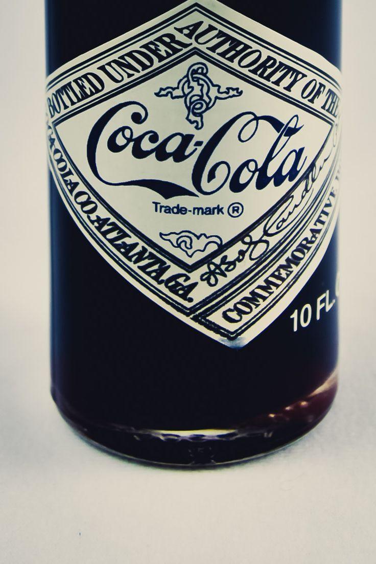 A few bottles of soda - Coca-Cola, World's 1st Coca-Cola Bottling Company...