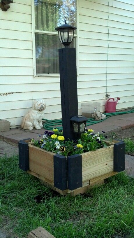 Made this today out of scrap lumber from our deck and a couple solar yard lights I had...yeah me!