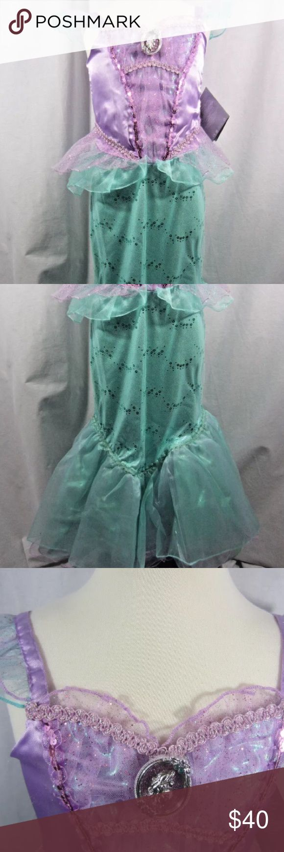 Disney Store The Little Mermaid Ariel Costume 9/10 Disney Store The Little Mermaid Princess Ariel child girls costume.  New with tags and 100% authentic Disney Store Costume. Size 9/10. Size chart is in images. All of my closet is kept in a climate controlled storage unit. Disney Store Costumes Halloween