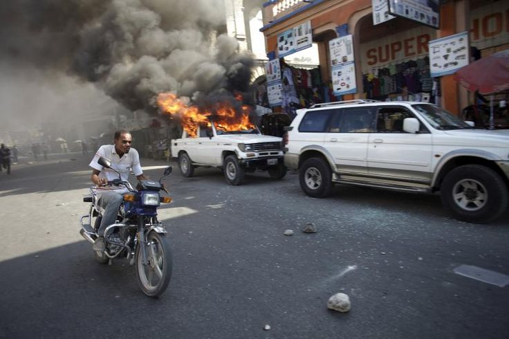 http://evememorial.org/ Protesters vow to derail Haiti presidential vote; election offices burned