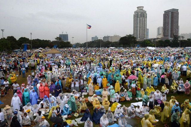 Hundreds of thousands of people gather to wait for a mass to be celebrated by Pope Francis at the Quirino Grandstand in Manila on January 18, 2015. Photo by Ted Aljibe/AFP