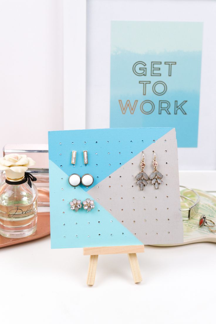 Organize both stud and dangling earrings with this DIY wood earring storage board you can customize with your favorite colors and patterns.