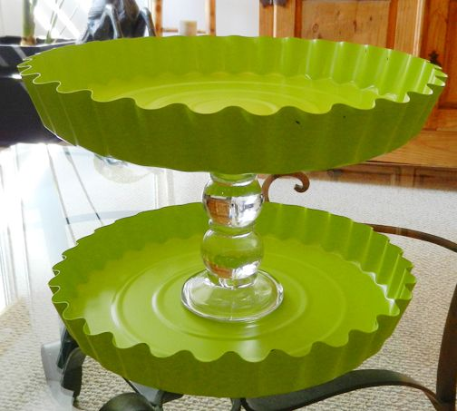 Cupcake or cookie stands made from candlesticks and spray painted tin pans from the dollar store.