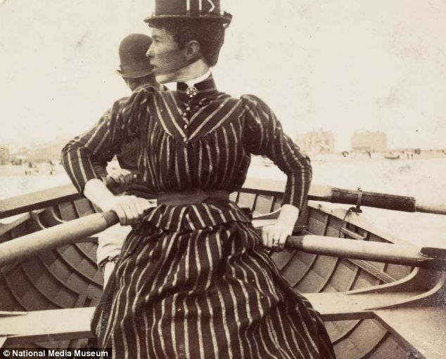 1888, Day out: A woman rows a boat on day out on the river