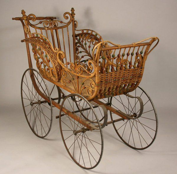 "Heywood Wakefield Wicker, ""The Heywood"" baby carriage. Ornately constructed with stick and ball decoration on sides. Retains original paint, original hardware, and metal name tag on front ""The Heywood."" 41"" Height x 26"" Width x 54"" Length. Circa 1880 #buggy #baby #wicker"