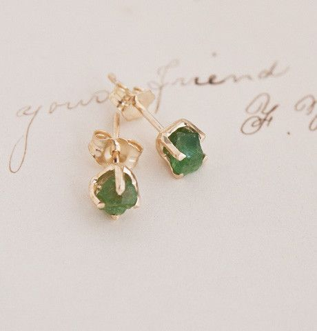 "Raw Emerald Earrings $425.00  ""1909"" is a new collection of jewelry, inspired by antiques and handmade in NYC.  Please allow us 4-6 weeks to build and deliver your piece to you.      For the past 4000 years, emeralds have been considered to be precious, powerful, healing stones.  Aristotle wrote that owning an emerald increases the owner's importance in presence and speech during business, gives victory in trials, helps settle litigation, and comforts and soothes eyesight."