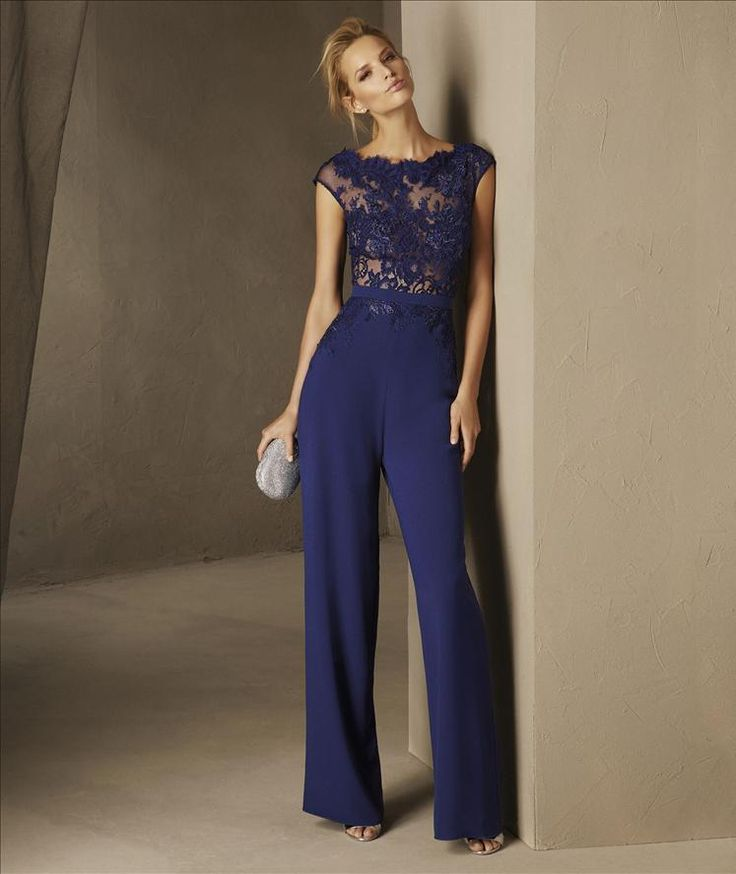 BREDA - Lace and guipure complement the straight pants in crepe that call attention to the wearer. This cocktail jumpsuit design is very daring, with a bateau neckline and fitted waist, combining its short sleeves and the sheerness of the bodice to create a refined mystery.