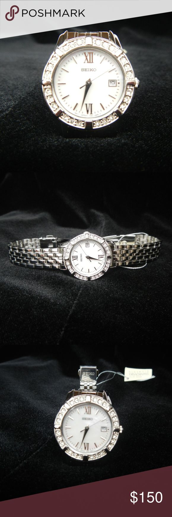 Seiko Ladies Watch - NWT Seiko Ladies Watch - NWT. The watch is polished stainless steel with a mother of pearl face surrounded by 24 sparkling Swarovski crystals. It is a standard size ladies watch, but it was just too big for my wrist. Seiko Accessories Watches