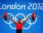 Steven Kari of Papua New Guinea competes in the men's 85kg Weightlifting event