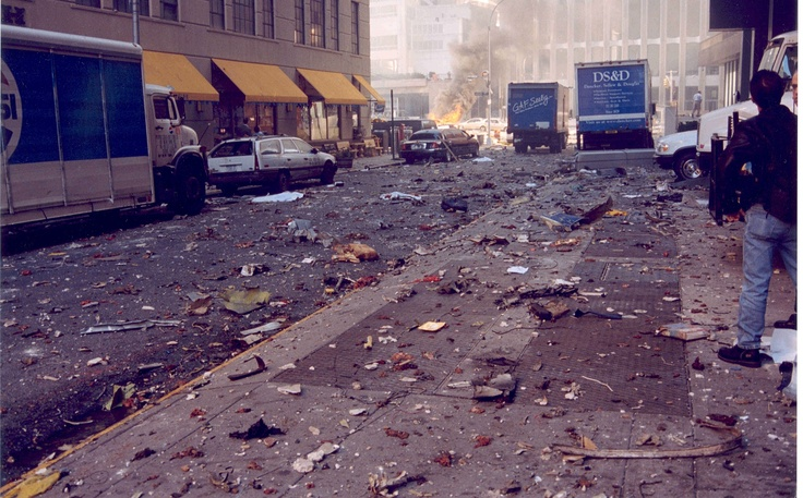 9/11 - Someone looks out at the debris all over, & neither of the towers had fallen - yet. One of the towers is in the background & no deadly dust cloud - yet. The world was about to change forever in 3-2-1...