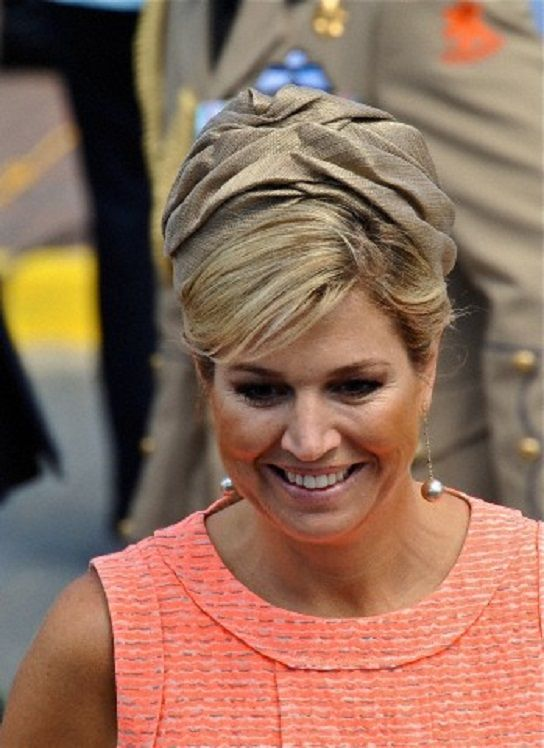 Dutch Queen Maxima hat details during visits to Aruba.
