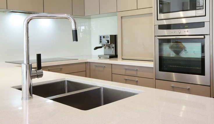 Melbourne kitchen renovation featuring Caesarstone in 'Ice Snow' with under-mounted sinks.