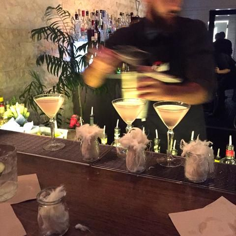 Lychee and Rose Petal Martinis served with fairy floss.