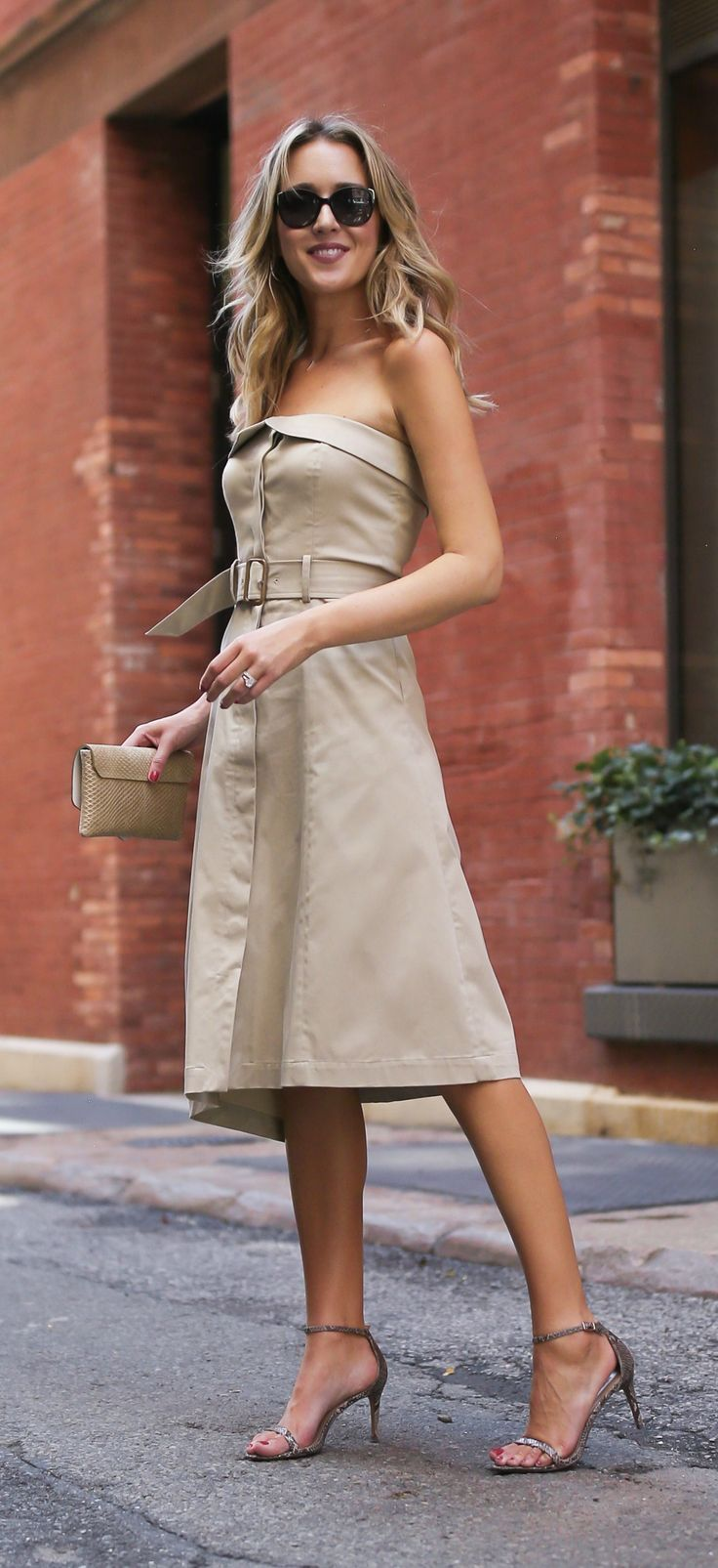 3 Day-To-Night Dresses You Need // Khaki fit and flare midi dress with asymmetrical hem + snakeskin strappy sandals, gold clutch and wavy hairstyle {Banana Republic}