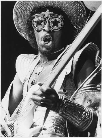 Bootsy Collins.  What's great about funk music, and people like Bootsy in particular, is that every photo/film you see them in, They always seem to be having the most awesome time.  Don't try to be cool, just give up the Funk!