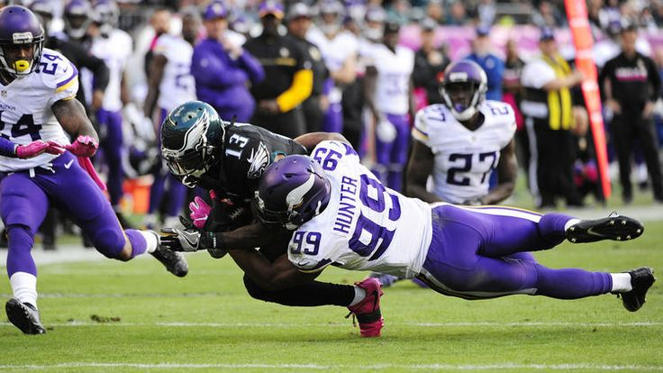 Wide receiver Josh Huff #13 of the Philadelphia Eagles is tackled by defensive end Danielle Hunter #99 of the Minnesota Vikings in the fourth quarter at Lincoln Financial Field on October 23, 2016 in Philadelphia, Pennsylvania. The Eagles defeated the Vikings 21-10. (Photo by Corey Perrine/Getty Images)