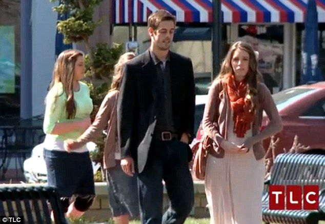Casual: The couple are seen taking a walk after lunch with two of Jill's sisters trailing behind as chaperones