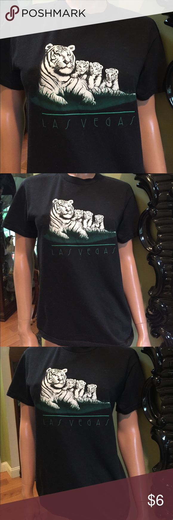 Las Vegas white tigers & cubs  black t shirt S Las Vegas white tiger and cubs t shirt this is a kids shirt marked L 14-16 but will fit a small woman so I listed it that way. Not forever 21 but listed here for visibility good used condition- still very black Forever 21 Tops Tees - Short Sleeve