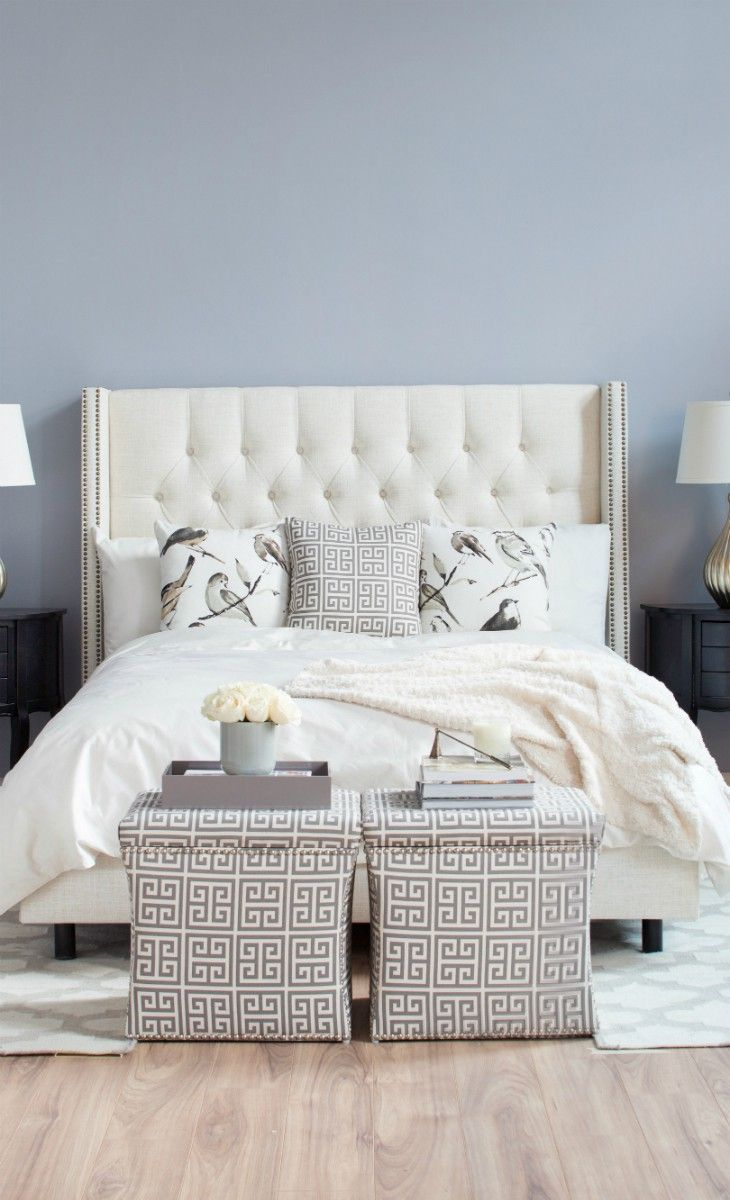 Love the two storage stools placed at the end of the bed!