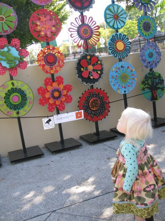 A young fan of Carol's admires the Art Prize Totems