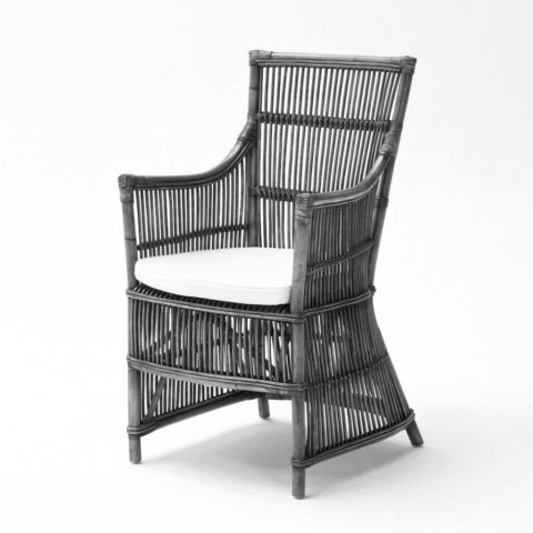 There's a reason this chair is called Duchess. The silhouette is definitely feminine with a slightly nipped-in waist and skirted base. The materials are exquisite and hand-woven from natural rattan. The design is striking with a straight cane formation.