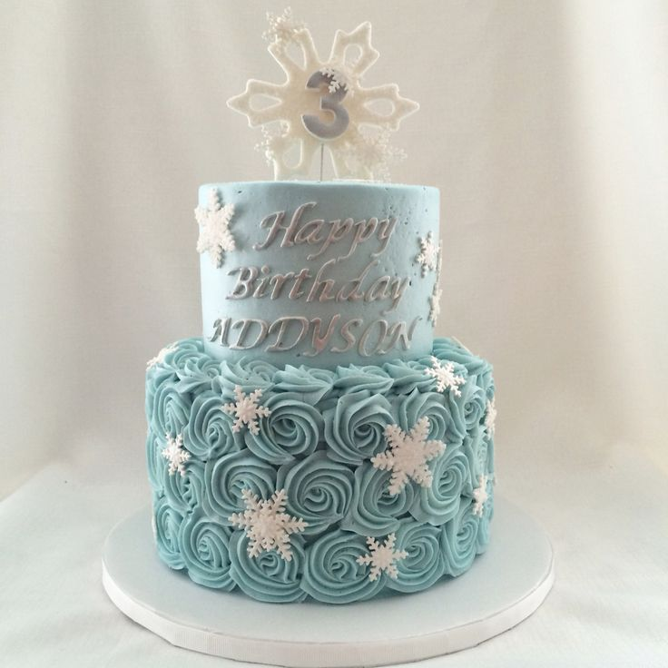 Frozen themed cake with buttercream rosettes and sugar snowflakes