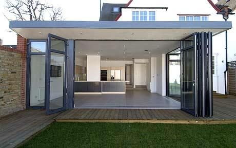 Glass walls: A house in Wandsworth's Broadgates Road, with a large family kitchen room extension with floor-to-ceiling foldaway glass walls onto the garden