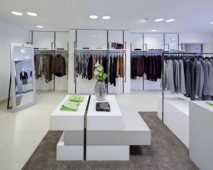 Австрийская аккуратность RIANI shop-in-shop concept at Mode Brühl от HEIKAUS, Грац, Австрия