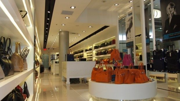 This retail location's perfectly monochromatic white design is a great way to show off the colorful product collection while maintaining an airy and clean look.