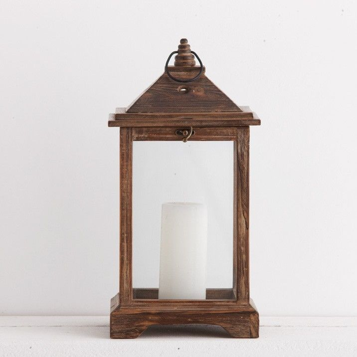 Add some character and light to your garden with this wooden lantern. This lantern is handcrafted from fir wood and stands at 43cm high.