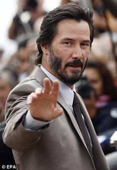 2015 September. Keanu Reeves in a dapper grey suit as he attends the Deauville American Film Festival in France. The 51-year-old teamed his suit with a pair of rugged suede shoes. dailymail.co.uk