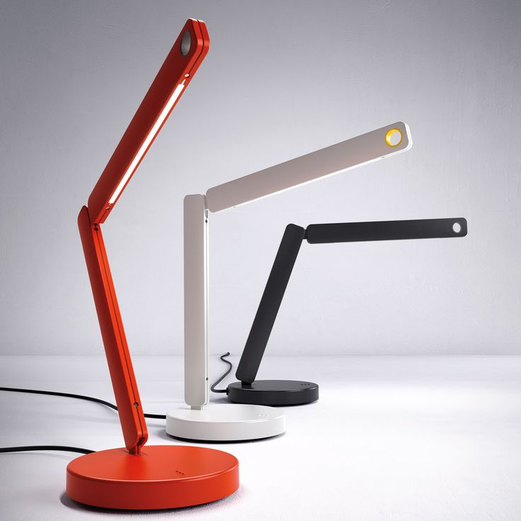 Row (lighting): Table lamp. Pivoting arms in aluminium. 360° rotating base in Zamac. Grip ring in plastic material. Touch dimmer switch. Diffused downward light emission. Available in orange with grip ring in slate grey, white with grip ring in yellow and black with grip ring in anthracite grey. (designer: Zaven   2013) - More @ www.fontanaarte.com #fontanaarte #light #lamp