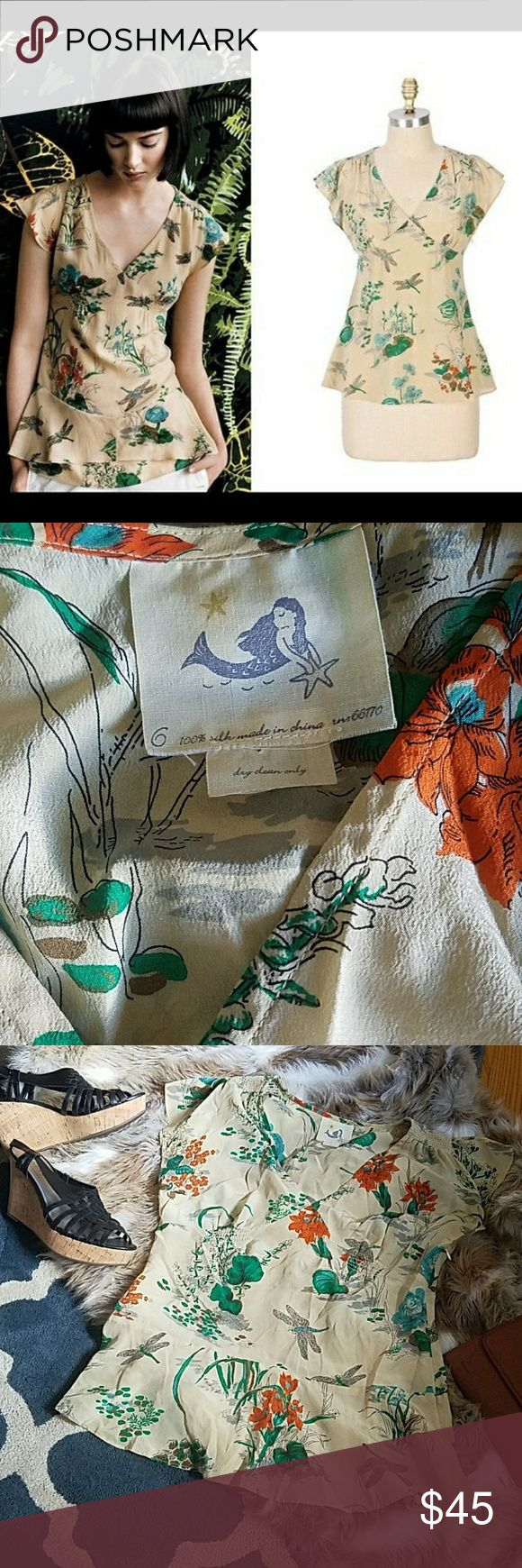 """ANTHROPOLOGIE MERMAID LABEL DRAGONFLY SILK TOP Emblems of summer illustrate tea-stained silk crepe. Sketchbook-style print of flowers, leaves and dragonflies is done in orange, light blue, jade green and grey on a pale beige background. Lightweight, delicate fabric. V-neckline. Empire waist, a-line cut through the body. Smocked gathers at the shoulders, under the bust and at center back. Unlined, closes with side zip. 100% silk. Underarm across 16"""". Length 25"""". Excellent condition (EUC)…"""
