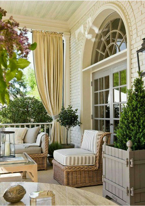 Elegant patio decor with wicker furniture in neutral colors